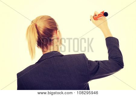 Business woman writing with oversized pen.