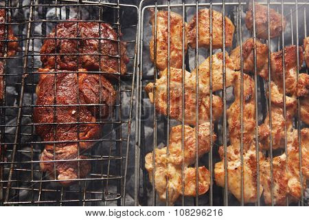 grilled roast meats chicken beef lamb fillet ribs on bbq grid over charcoal