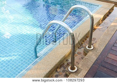 Swimming pool with stair.