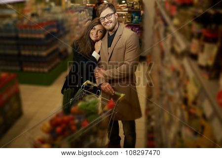 Young couple in a grocery store