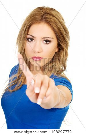 Young woman making disagree sign with her finger.