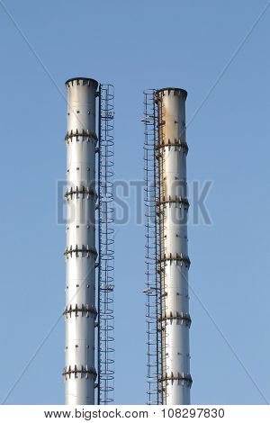 Industrial chimney against clear sky