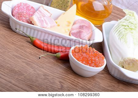 Food High In Protein, Sausages, Cheese, Red Pepper, Red Caviar, Cabbage
