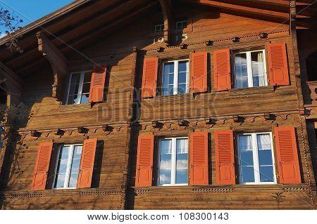 Exterior of a traditional Swiss wooden chalet in Brienz, Switzerland.