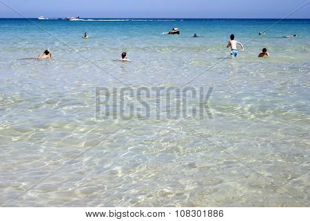 Chia, Italy-july 15: Unidentified People  And Boats In A Caribbean Sea In Summertime On July 15.2013