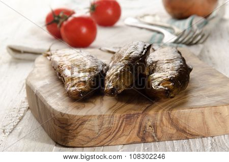 Smoked Vendace On Wooden Board