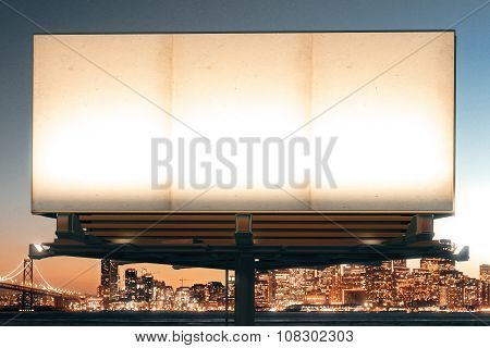 Mock Up Of Blank Billboard On The Background Of The City At Night