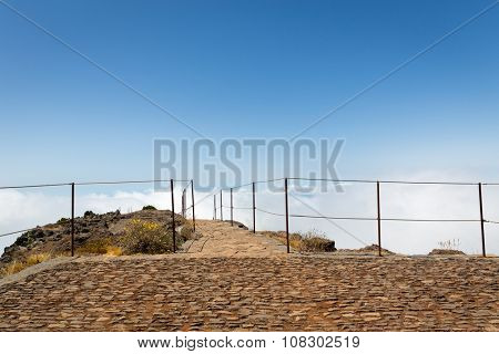 Observation platform with fence in mountains against sky, Portugal, Madeira