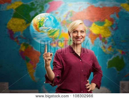 Travel agent woman with a globe against a map of the world
