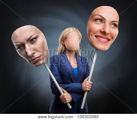 Businesswoman choosing face over grey background