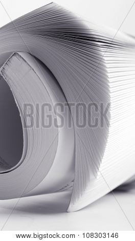 Abstract macro of a rolled catalog