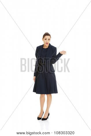 Anoyed and displeased businesswoman standing