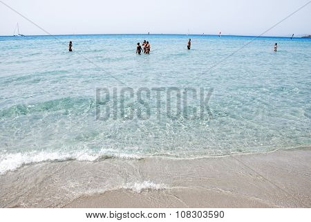 Porto Pino, Italy-august 06: Unidentified People Walking In The Sea In Summer Time On August 06.2012