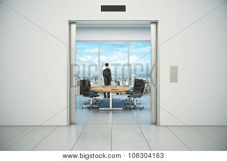 Modern Conference Room With Businessman And City View From The Lift Entrance