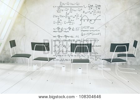 Modern Calssroom With Equations On Concrete Wall, Chairs And Cups Of Coffee