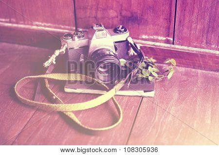Old Style Camera With Diary On A Wooden Floor, Instagram Photo Effect
