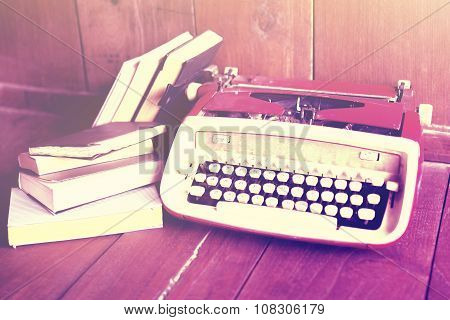 Old Style Typewriter And Book On A Wooden Floor, Instagram Photo Effect