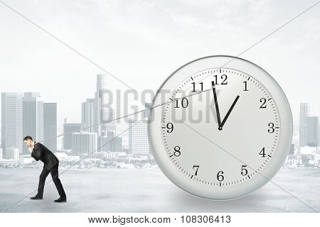 Businessman Trying To Return The Time With Rope, Stop The Time Concept