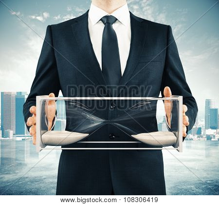 Businessman With Frozen Hourglass, Time Concept