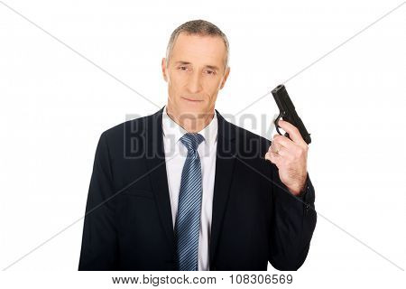 Serious mature mafia agent with handgun.