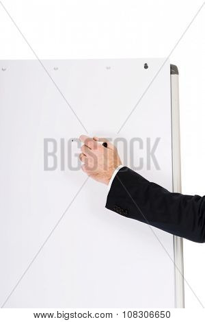 Businessman hand writing on a flipchart