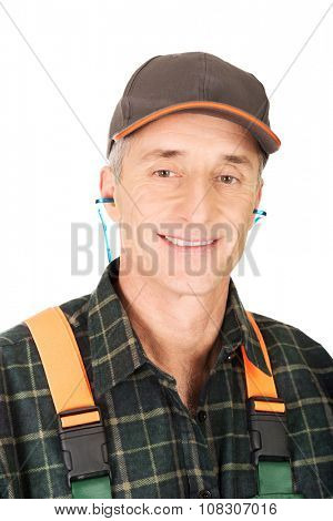 Experienced gardener wearing ear protectors