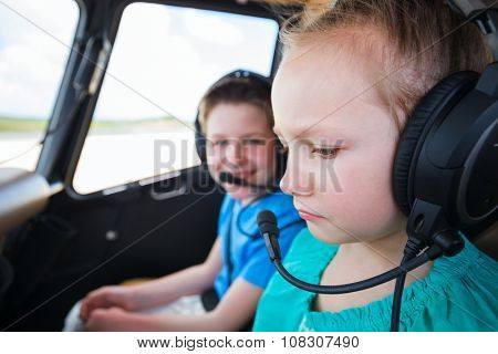 Kids at cabin of helicopter before flight with little girl 