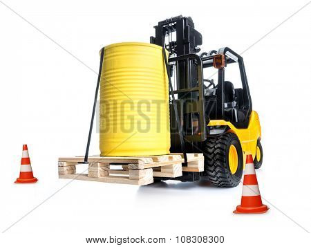 forklift truck with yellow container placed on wooden pallet shot on white background