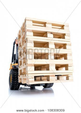 Forklift truck carrying stacked wooden pallets shot on white background