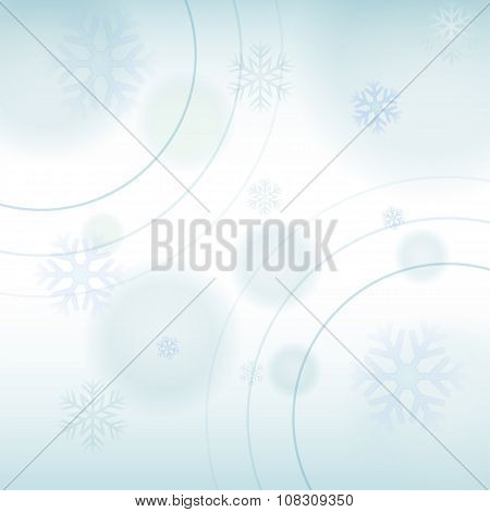 Abstract Winter Light Blue Background With Snowflakes