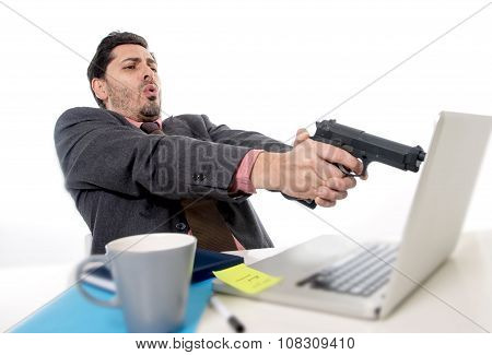 Businessman In Suit And Tie Sitting At Office Desk Working On Computer  Pointing Gun To Laptop In Bu
