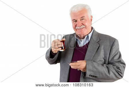 Senior Businessman Holding A Glass Of Turkish Tea