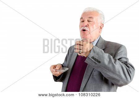 Senior Man Enjoying A Cup Of Turkish Tea