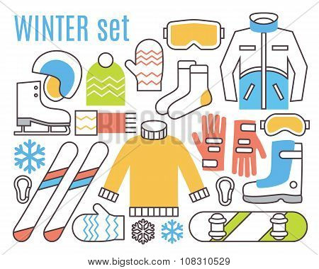 Winter sport activities. Snowboard, ski and warm cloths.