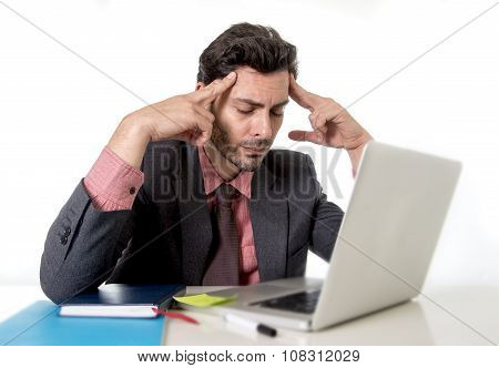 Young Attractive Businessman Sitting At Office Desk Working On Computer Laptop Suffering Headache