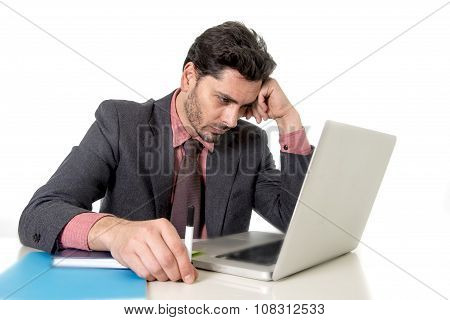 Young Businessman Sitting At Office Desk Working On Computer Laptop Desperate Worried In Work Stress