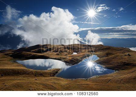 Mountain Lake. Sunny day with blue sky. Beautiful sun rays. Lake Koruldi. Caucasus, Georgia, Zemo Svaneti