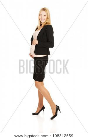 Smiling pregnant woman in formalwear.