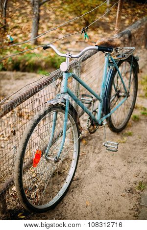Parked vintage old bicycle bike in courtyard.