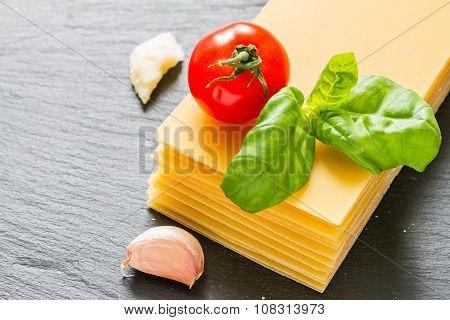 Lasagne ingredients on stone background