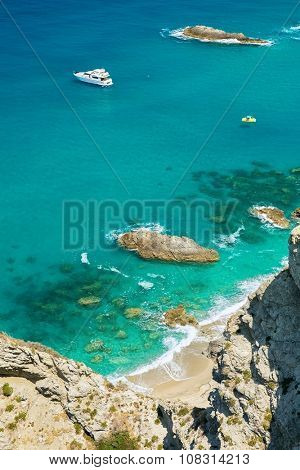 Small boats on the crystal clear sea  near the town of Tropea region Calabria - Italy