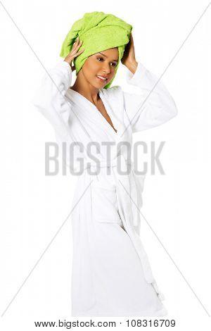 Beautiful spa woman in bathrobe and turban.