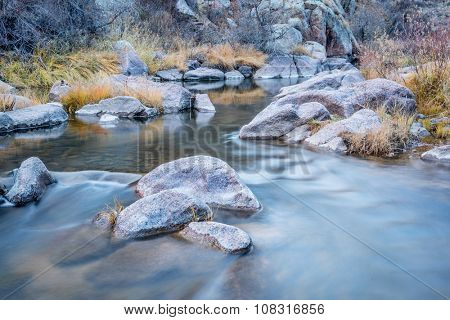 mountain stream in northern Colorado - North Fork of Cache la Poudre River at Eagle Nest Open Space near Livermore,late fall scenery