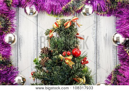 New Year Theme Christmas Tree With Pink And Green Decoration And Silver Balls On White Retro Stylize