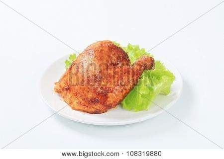 Garlic roasted chicken leg quarter with lettuce