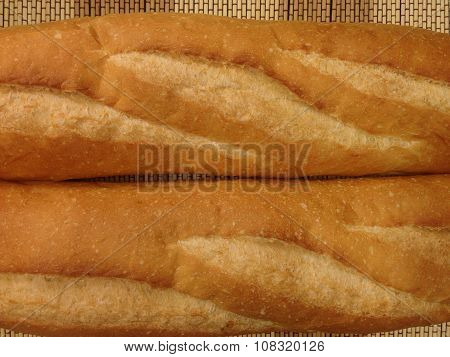 Bakery Bread of Baguette on  a Wooden Table.