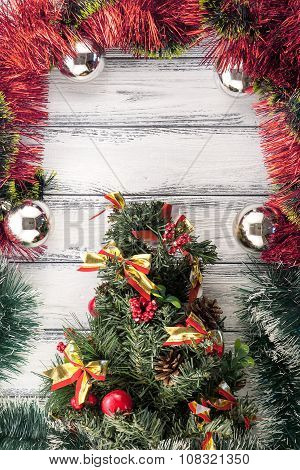 New Year Theme: Christmas Tree With Red And Green Decoration And Silver Balls On White Retro Stylize