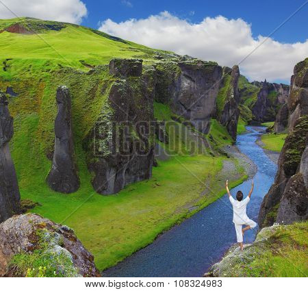 Woman dressed for yoga on a rock canyon  Fjadrargljufur. Fantastic country Iceland