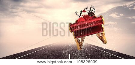 Santa flying his sleigh against cloudy landscape background with street