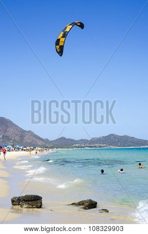 Blue Beach With People And Kite Surf In A Summer Day